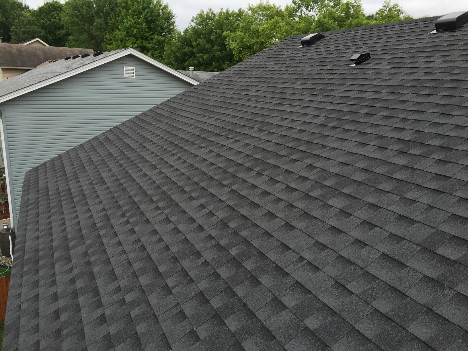 Here is an after photo of the finished roof replacement. GAF Armourshield Timberline shingles in Charcoal Black.