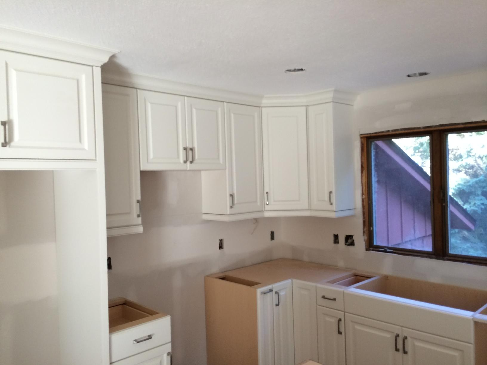 Progress photo with newly installed cabinetry.
