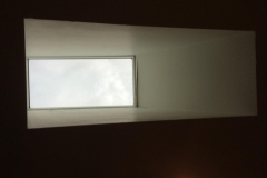Photo from inside of the home looking up at the replaced skylight window.