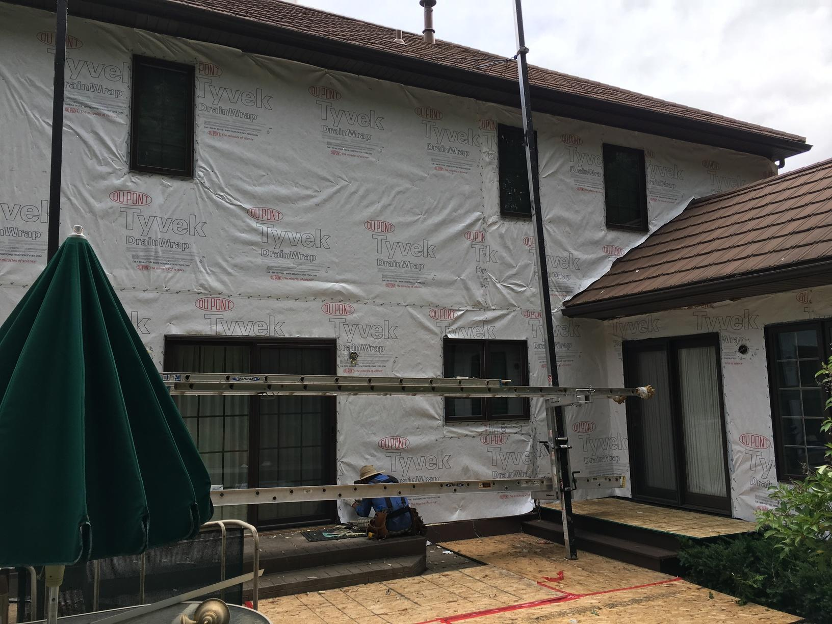 Progress picture. Tyvek brand house wrap.