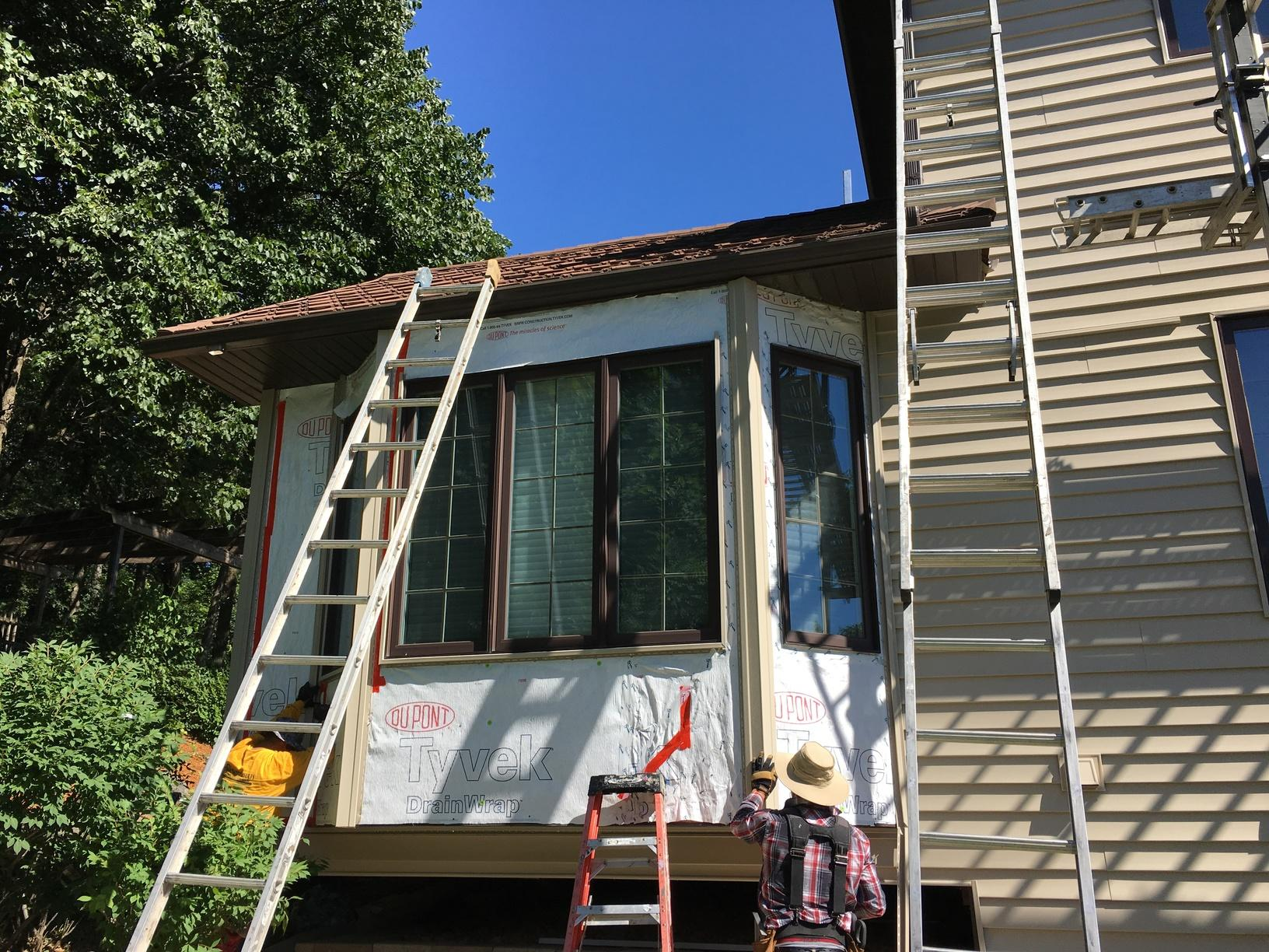 Progress photo of bay window siding restoration.